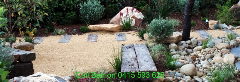 australia-landscape-design-granitic-sand-and-sleeper-pathway-with-natives-pebbles