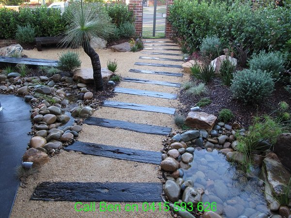 c-sleepers-in-pathway-graniticsand-grasses-blackboy-peddbles